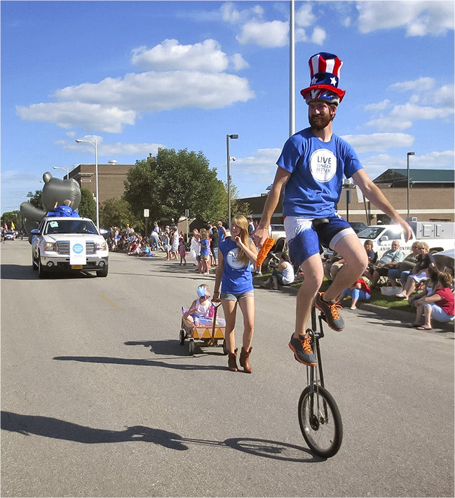 man on unicycle in street parade