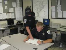 Two officers looking at paperwork