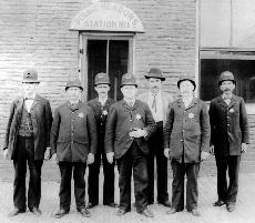 Seven Smiling Officers in Black and White Picture from 1898